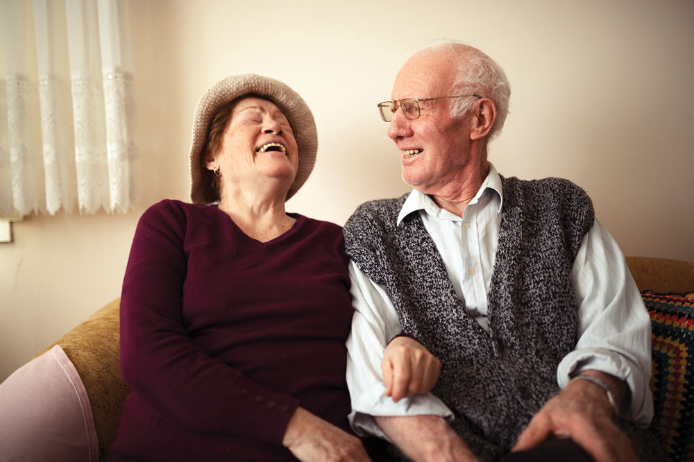 Memory Care Residents sitting beside each other on a couch