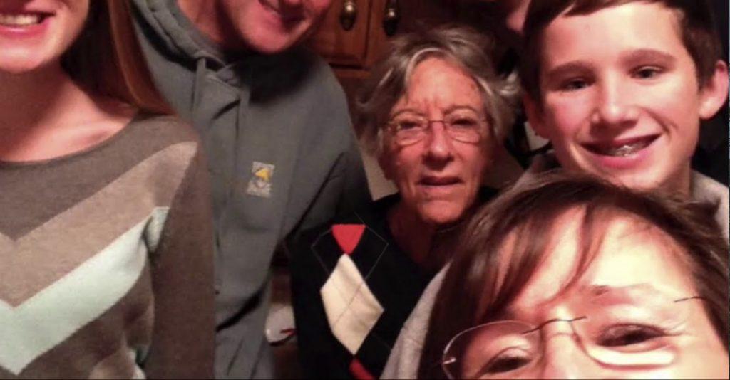 Charter Senior Living of Oak Openings Video Thumbnail Family Group Surrounded by senior living resident